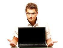 Young worker presenting a laptop Royalty Free Stock Photography