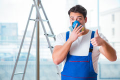 The young worker with protective face gas mask Stock Photography