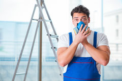 The young worker with protective face gas mask Royalty Free Stock Images