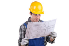 Young worker reads a plan Royalty Free Stock Images