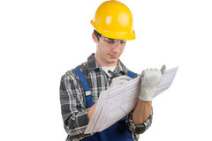 Young worker reads a plan Royalty Free Stock Photos
