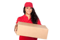 Young worker with red uniform and a box. Isolated on white background stock image