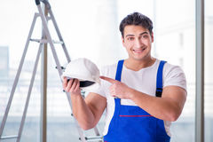 The young worker with safety helmet hardhat. Young worker with safety helmet hardhat Royalty Free Stock Images