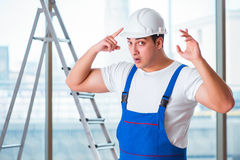 The young worker with safety helmet hardhat. Young worker with safety helmet hardhat Royalty Free Stock Image