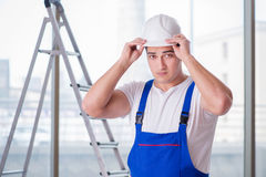 The young worker with safety helmet hardhat. Young worker with safety helmet hardhat Stock Images