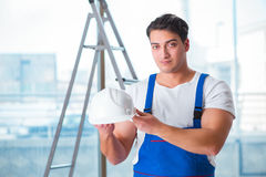 The young worker with safety helmet hardhat. Young worker with safety helmet hardhat Royalty Free Stock Photo