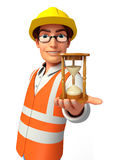 Young worker with sand clock Royalty Free Stock Image