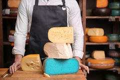 Young worker in   shop. Young worker in cheese shop Royalty Free Stock Photography