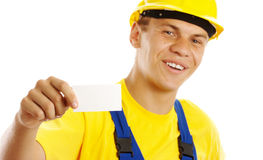 Young worker showing his business card and smile Royalty Free Stock Image