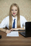 Young worker signs a new contract Royalty Free Stock Photography