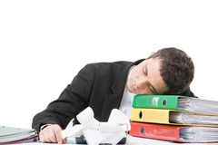Young worker sitting at desk and sleeping. Royalty Free Stock Photo