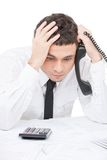 Young worker sitting at desk and thinking. Royalty Free Stock Images
