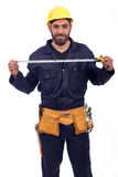 Young worker smiling. Smiling beard young worker holding tape measure, man wearing workswear and belt equipment, isolated on white background Royalty Free Stock Photos
