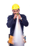 Young worker smiling. Smiling beard young worker measuring by tape measure and looking up, man wearing workswear and belt equipment, isolated on white background Stock Photography