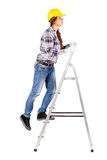 Young worker stands on the stairs looks straight ahead Royalty Free Stock Photography