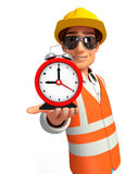 Young worker with table clock Stock Photos