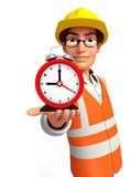 Young worker with table clock Royalty Free Stock Photos
