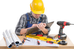 A young worker with a tablet Royalty Free Stock Images