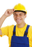 Young worker taking off his hard hat and smile Royalty Free Stock Photos