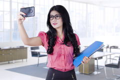 Young worker taking selfie in office Stock Photography