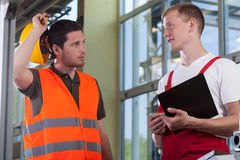Young worker talking with manager Stock Images