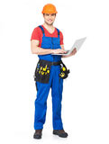 Young worker with  tools holds the laptop Stock Photos