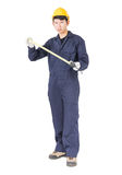Young worker in unifrom with tape measure on white Royalty Free Stock Image