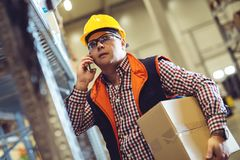 Worker In Warehouse Preparing Goods For Dispatch Royalty Free Stock Photography