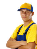 Young worker wearing baseball hat and uniform Stock Photo