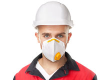 Young worker wearing safety protective gear. Portrait of young worker wearing safety protective gear isolated on white background Royalty Free Stock Photo