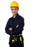 Young worker wearing yellow hard hat Stock Photo
