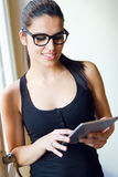 Young worker woman with digital tablet in her office. Portrait of Young worker woman with digital tablet in her office Stock Image