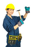 Young worker woman with hammer stock photography