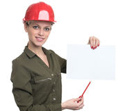 Young worker woman holding a blank poster Stock Photo