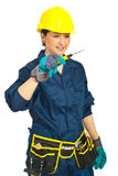Young worker woman holding screwdriver Stock Photo
