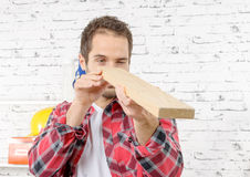 Young worker with a wooden board Stock Photography