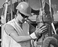 Young worker at work with the pump Royalty Free Stock Image