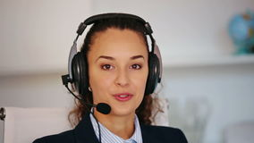 A young worker working in the call center stock video
