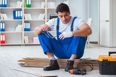 The young worker working on floor laminate tiles Royalty Free Stock Photo