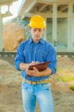 A young worker writing in clipboard Royalty Free Stock Images