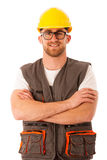 Young worker wtih protective dress and yellow helmet isolated ov Stock Photo