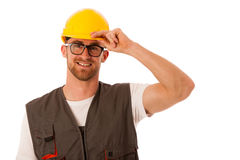 Young worker wtih protective dress and yellow helmet isolated ov Royalty Free Stock Photo