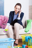 Young working mother talking on phone Royalty Free Stock Image