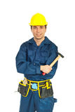 Young workman holding hammer Royalty Free Stock Image