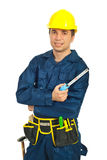 Young workman holding ruler Stock Image