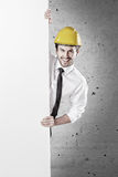 Young workman smiling and holding a white banner Stock Photos