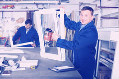 Young workman is taking order from customer Stock Photography