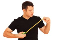 Young workman with tape measure on white Stock Photography