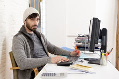 Young worried businessman in cool hipster beanie look looking desperate having problem working in stress Stock Photography