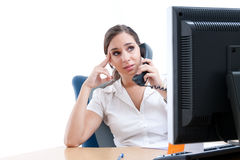 Young worried businesswoman behind her desk Stock Images
